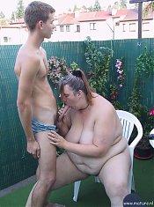 Fat housewife sucking cock in her garden