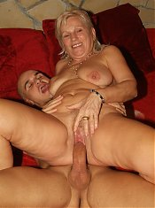 Mean granny Remy does a kinky striptease and fills her mouth and pussy with a throbbing dick