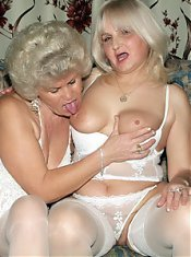 Francesca and Erlene show off their big saggy tits and spread their flabby thighs for a dildo live